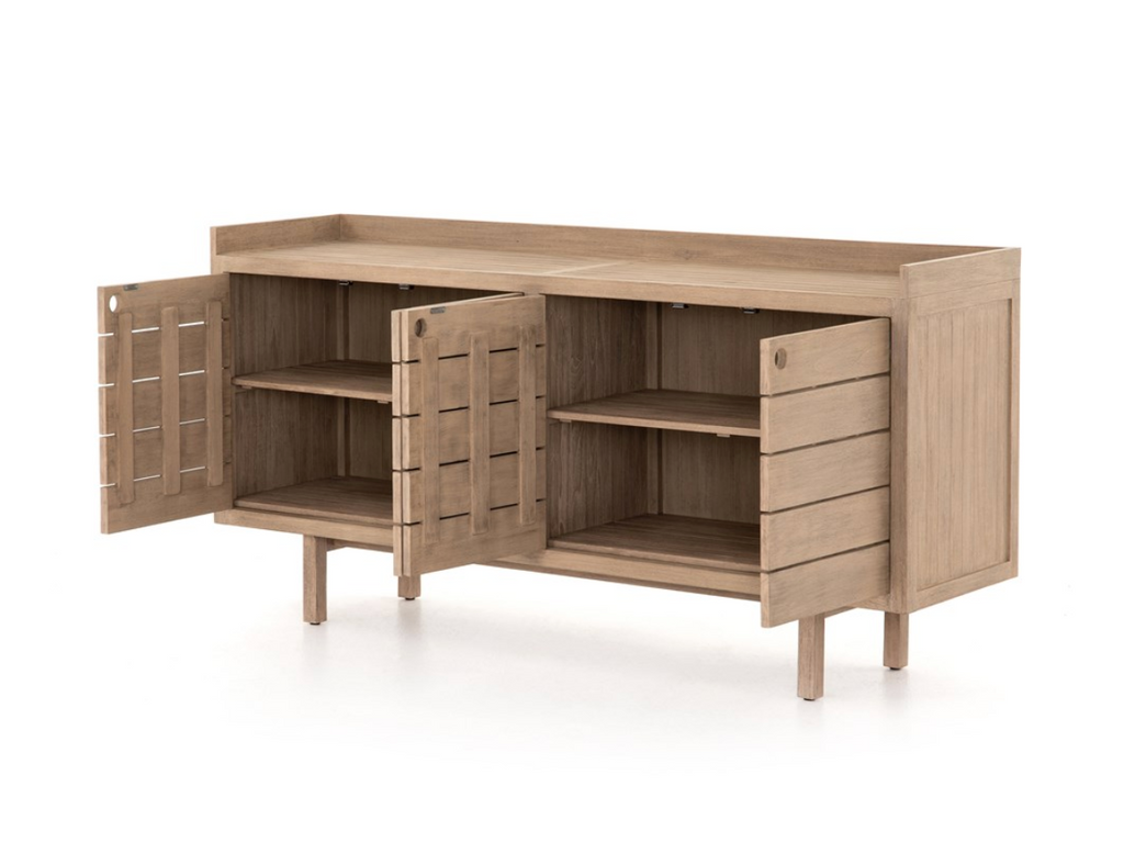 Bring style and storage outdoors with the Lula Outdoor Sideboard available in two colors of Washed Brown or Weathered Grey. Washed brown-finished teak features slatting for an open, textural look, with cutout openings in place of hardware. Gallery top ready for outdoor entertaining. Cover or store inside during inclement weather and when not in use.
