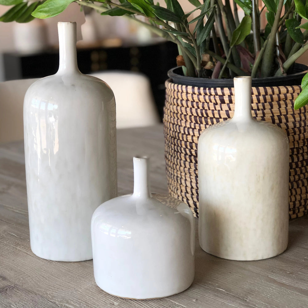 This precious vase is perfect to showcase a select few flowers in your home! The hand-crafted glazed vase will vary with each vase to make it uniquely yours.