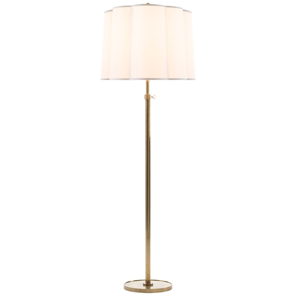 "We love the silk shade of the Simple Soft Brass Floor Lamp. It adds an elegant, warm glow to any room  Height: 62.5"" - 80"" Width: 22"" Base: 12"" Round"