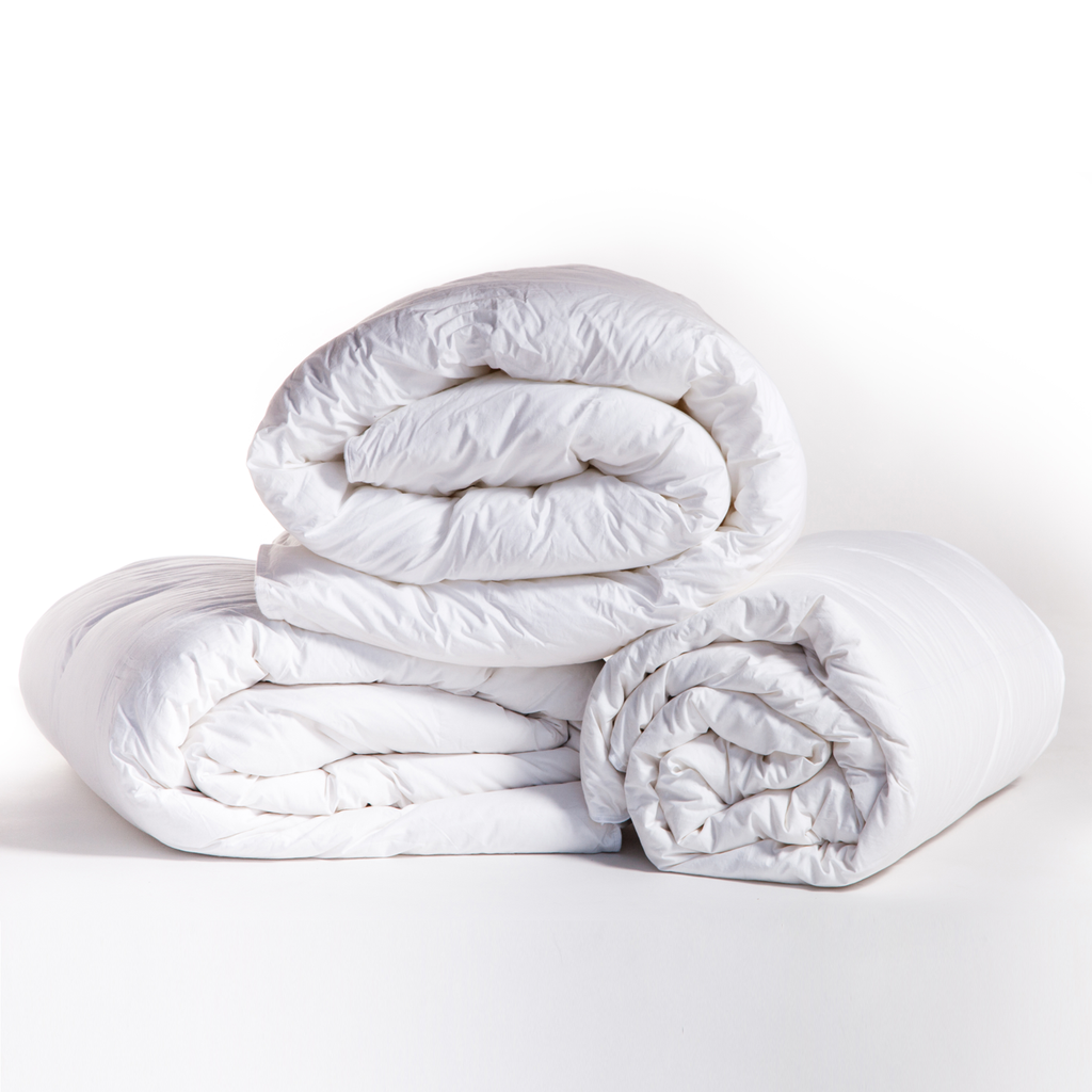 "This Spring Weight Duvet Insert by Pom Pom at Home is a cozy dream made of 100% cambric cotton lining and is hypoallergenic. Perfect for those who live in warmer climates  Fill: 600 Fill Power Premium White Duck Down  Twin - 68""x88"" Queen - 92""x96""  King - 106""x96"""