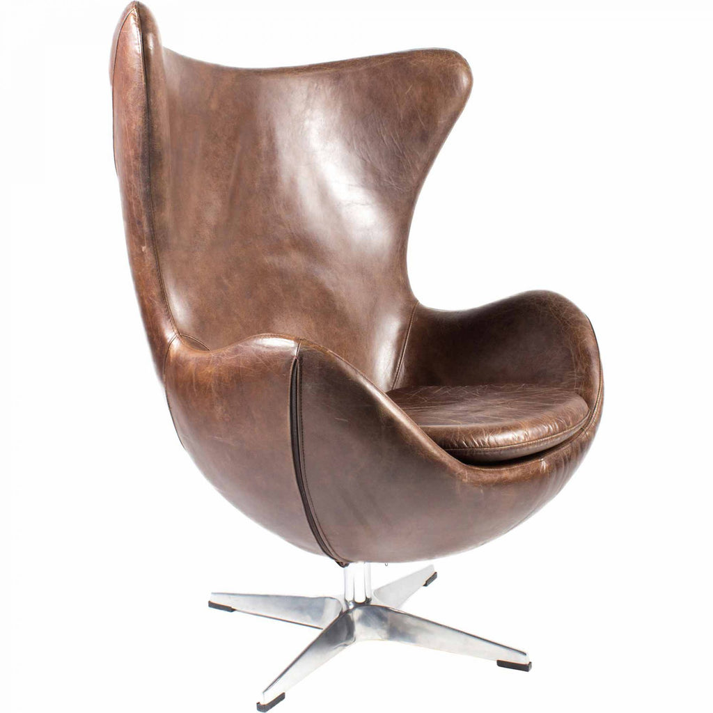 "We love the high-back design of this St. Anne Brown Swivel Club Chair. The dark top-grain leather gives us all the mid-century modern vibes and would complete the look for any living room or office space.  Size: 35""W x 31.5""D x 41""H Seat Height: 19"" Back Height: 22"" Arm Height: 7""   Materials : Top Grain Leather, Stainless Steel"