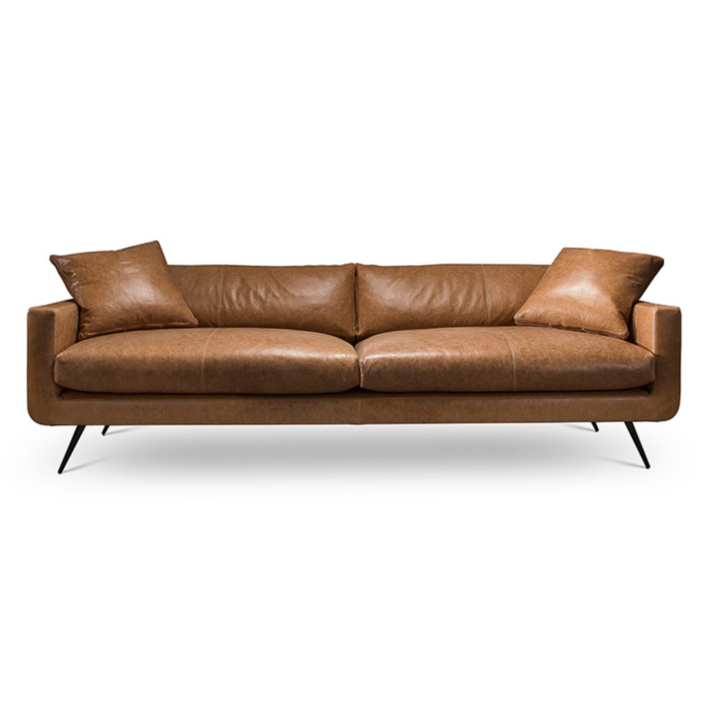 "Instantly a modern classic, the Stella Sofa Family by Verellen is made with a sustainably harvested hardwood frame and 8-way hand-tied seat construction. It comes standard with:  • Spring Down Seat Construction • Boxed Back Pillows • Loose Bullnose Style Dual Seat Cushion • Boxed Toss Pillows • Center Seam on Front Rail • Double Needle • 8""H Metal Conical Leg with Black Matte Finish • Slipcover Not Available • Available as a Sectional"