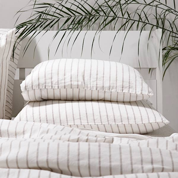 We love the calm pattern of this Stripe Natural Washed Pillow Case by LinenMe. Made from 100% prewashed pure linen, this is an incredibly soft and cozy pillow case to snooze into after a long day. Ships from LTU. Will ship within 30-45 days. Tumble Dry.