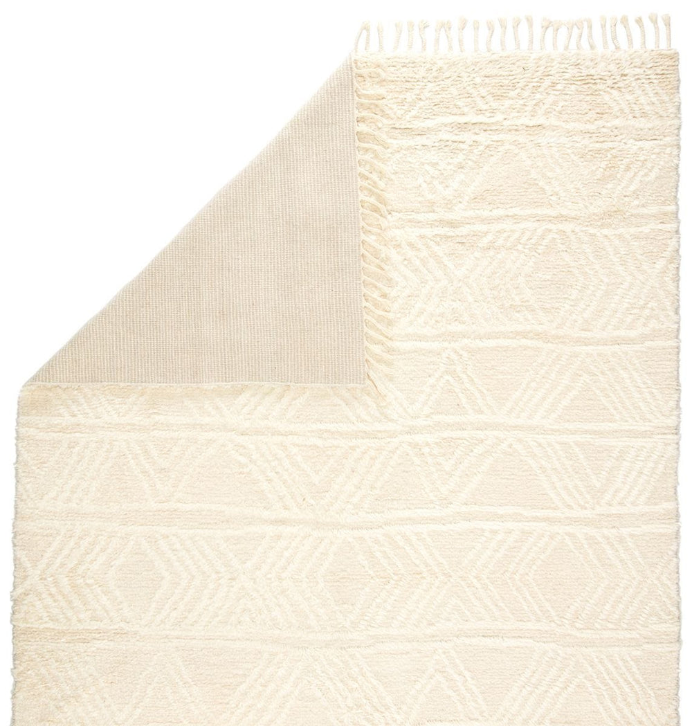 The Tala collection of hand-knotted rugs brings a new sense of luxury and comfort to the contemporary home. The plush Akka rug makes a modern Moroccan statement, showcasing a textural geometric motif in a solid, inviting cream hue. Braided tassels complete bohemian effect of this gorgeous rug.  Hand-Knotted  100% Wool TAL07 Tala Akka Rug