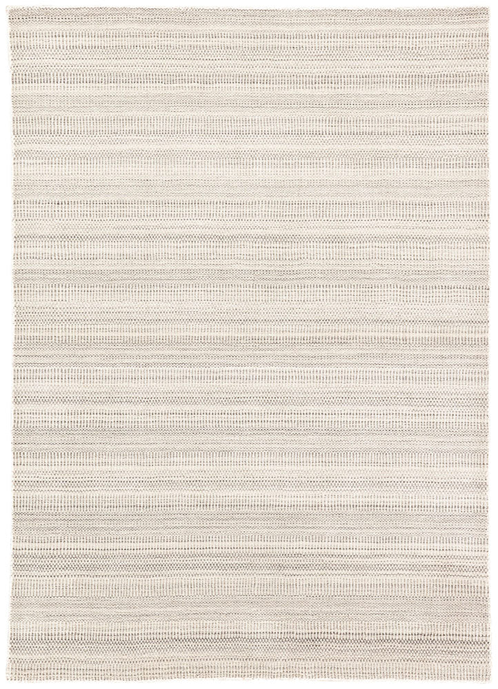 The Minuit area rug from the Trendier collection brings dimension to any room with a finely detailed pattern in variegated neutral colorway. Soft to the touch, this hand-loomed wool and viscose accent effortlessly blends inviting texture and a timeless design.  Hand Woven 80% Wool | 20% Viscose TEI01