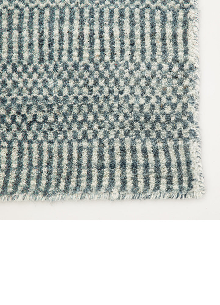 The Minuit area rug from the Trendier collection brings dimension to any room with a finely detailed pattern in variegated dark blue and ivory colorway. Plush and luxuriously dense, this hand-loomed wool accent effortlessly blends inviting texture and timeless design.  Hand Woven 100% Wool TEI03