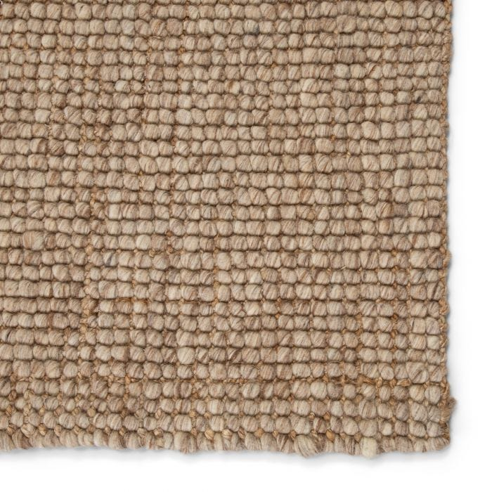 The Tioman collection brings rich, natural texture to ground any styled space. Handwoven of jute and soft, wool yarn, the inviting Oceana area rug features an earthy-toned blend of tan and taupe.  Natural  62% Wool | 38% Jute TIM02 Tioman Oceana Rug