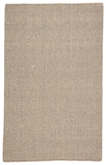 The Tioman collection brings rich, natural texture to ground any styled space. Handwoven of jute and soft, wool yarn, the inviting Chael area rug features an earthy-toned blend of beige and light gray.  Natural  58% Wool | 42% Jute TIM03 Tioman Chael Rug