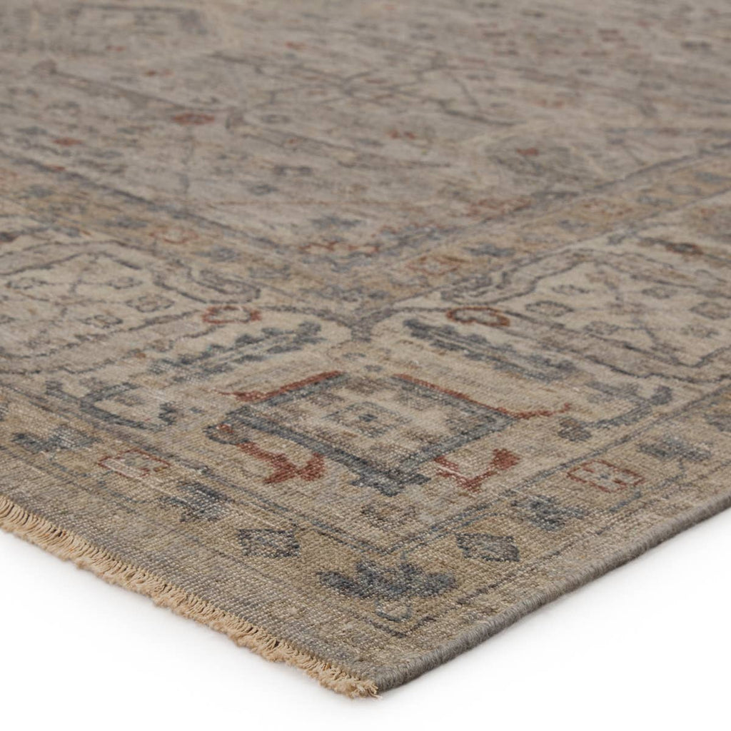 The Tierzah Maison Area Rug by Jaipur Living, or TRZ04, boasts a Persian knot construction and neutral beige, taupe, and gray palette with rich hints of terracotta. This artisan-made rug features fringe trimmed details for a touch of global charm. This is perfect for your bedroom or other medium traffic area.
