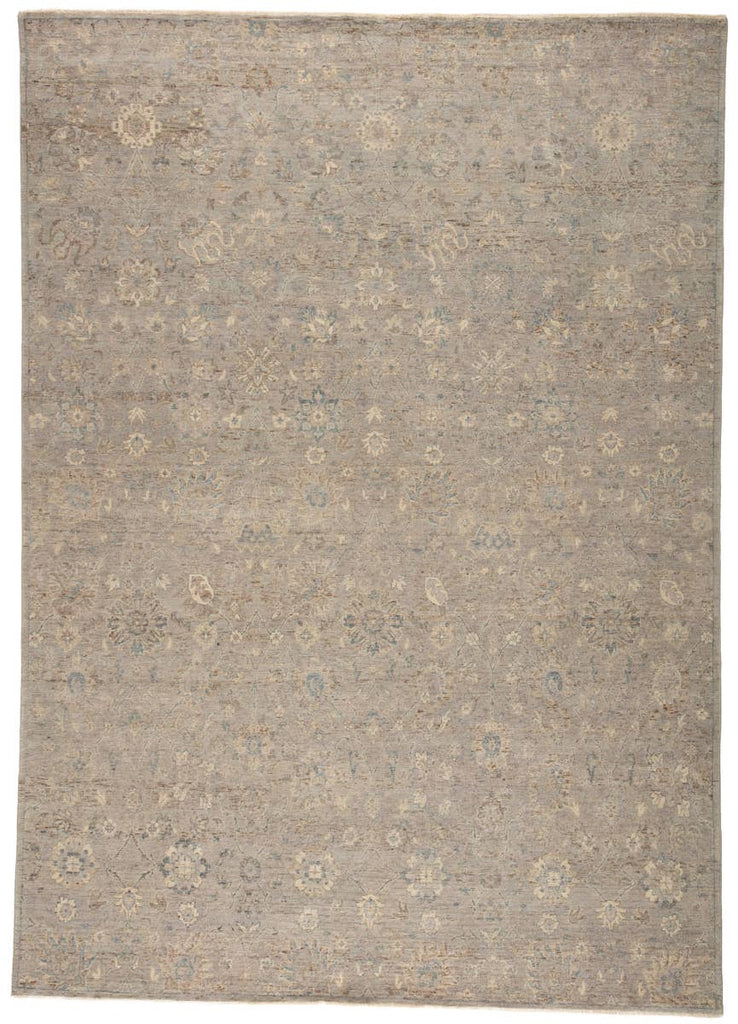 The Tierzah Pembe Area Rug by Jaipur Living, or TRZ02, boasts a Persian knot construction and tonal gray, beige, and brown palette that grounds any space. This artisan-made rug features fringe trimmed details for a touch of global charm. This is perfect for your living room, bedroom, or other medium traffic area.