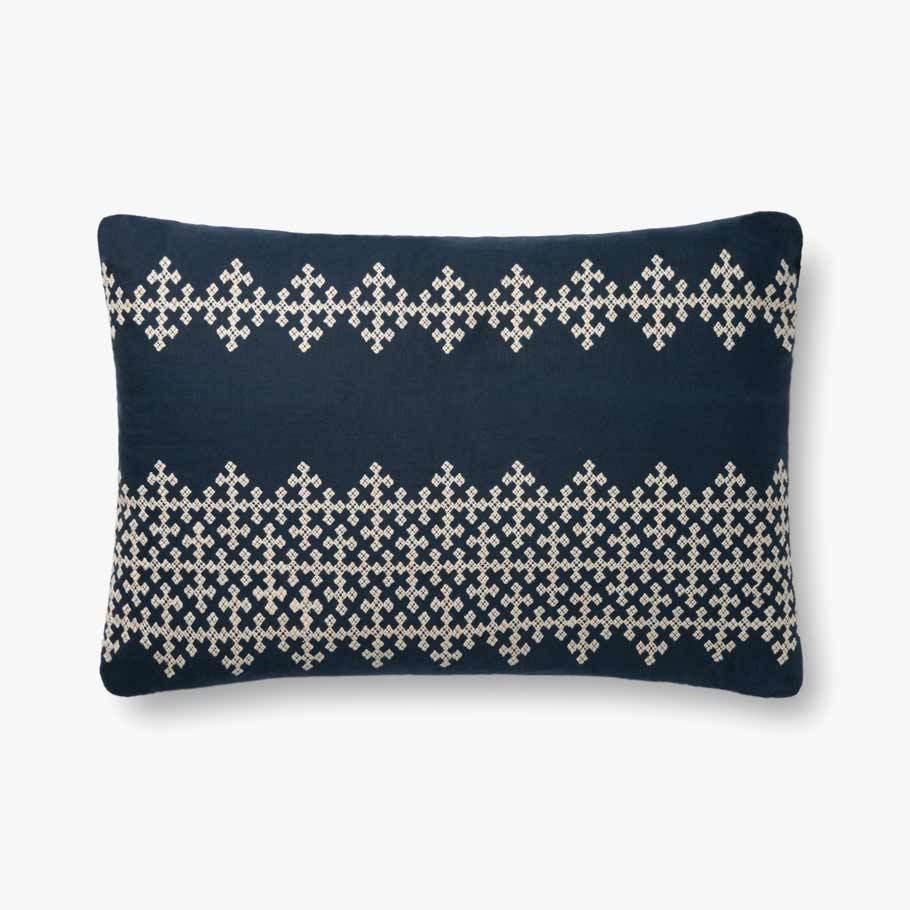The gorgeous Toulon Navy/Ivory Pillow has a beautiful and comfortable blend of linen, cotton, and viscose. The soft textures across the pillow make this a quick favorite around the home. Adding even more comfort, the pillow includes a down feather insert.