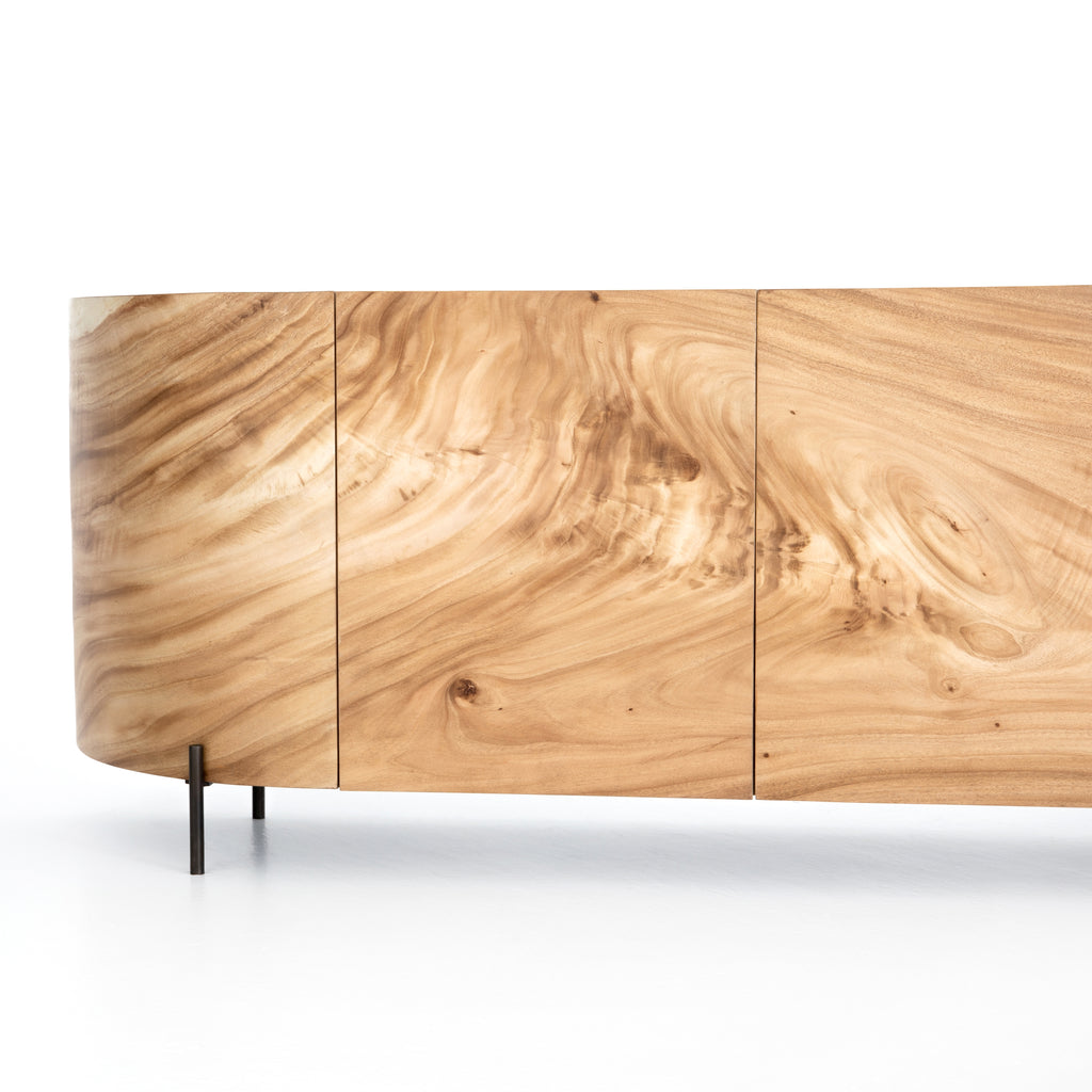 With soft shaping and inset top inspired by classic jewelry setting, gold guanacaste forms a beautifully sculpted silhouette, with natural high and lowlights coursing the entirety of this richly styled sideboard.