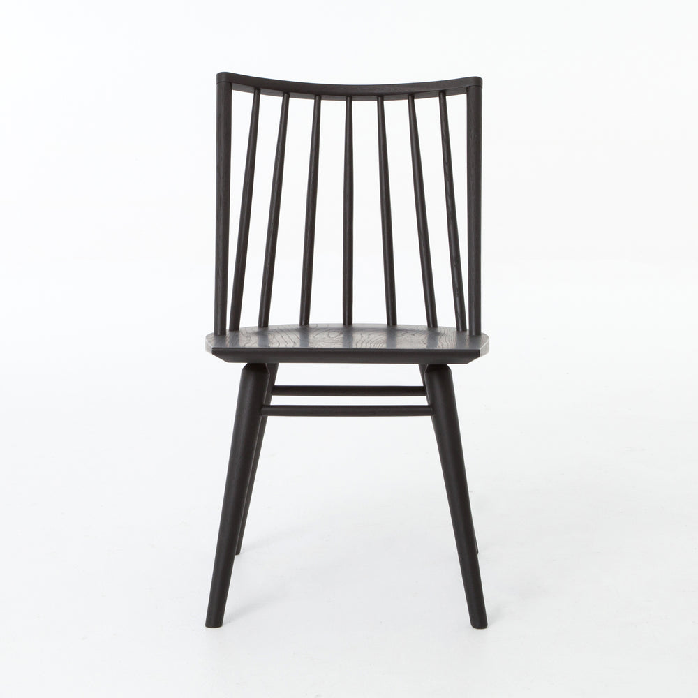Try a cleaner, more modern take on the traditional Windsor. This tall beauty is wire-brushed to bring out the cathedral grain in the oak, and stained deep black for lovely contrast with more industrial decor.