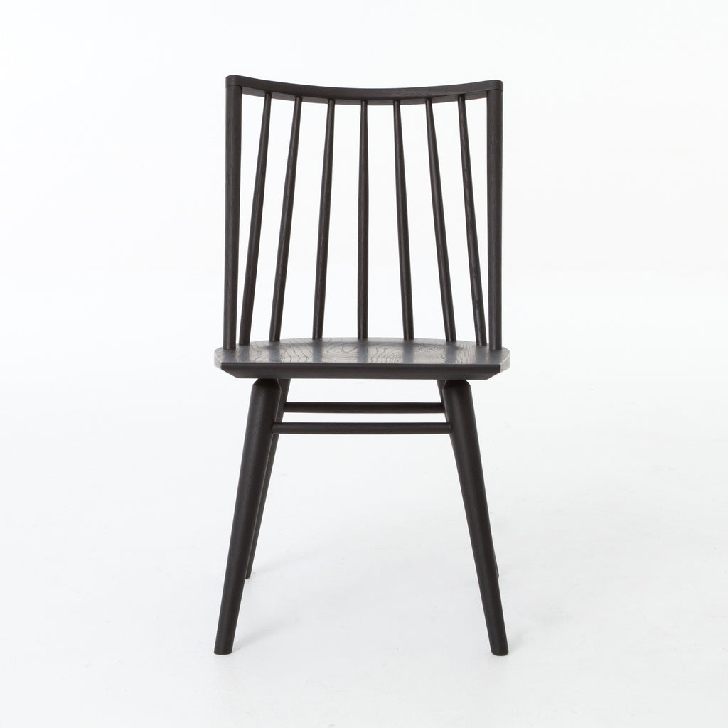 Try a cleaner, more modern take on the traditional Windsor with our Windsor Dining Chair. This tall beauty is wire-brushed to bring out the cathedral grain in the oak, and stained deep black for lovely contrast with more industrial decor. This chair is perfect for a dining room or that special nook in your home.