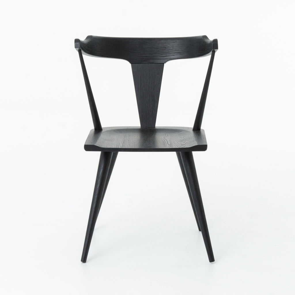This new take on the mid-century Windsor chair, the Ripley Dining Chair has a bowed, sculptural silhouette. A soft black finish adds movement to the wood by highlighting the natural grain of weathered oak. The chair is perfect for the chic, modern dining room look.