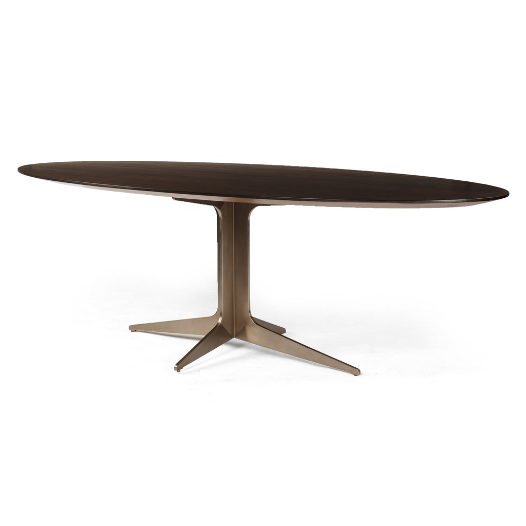 Modern metal brings bold edge to warm woods. Bronzed legs of stainless steel support an extended oval top, bringing a fresh fusion of industrial and soft fluidity to the table.