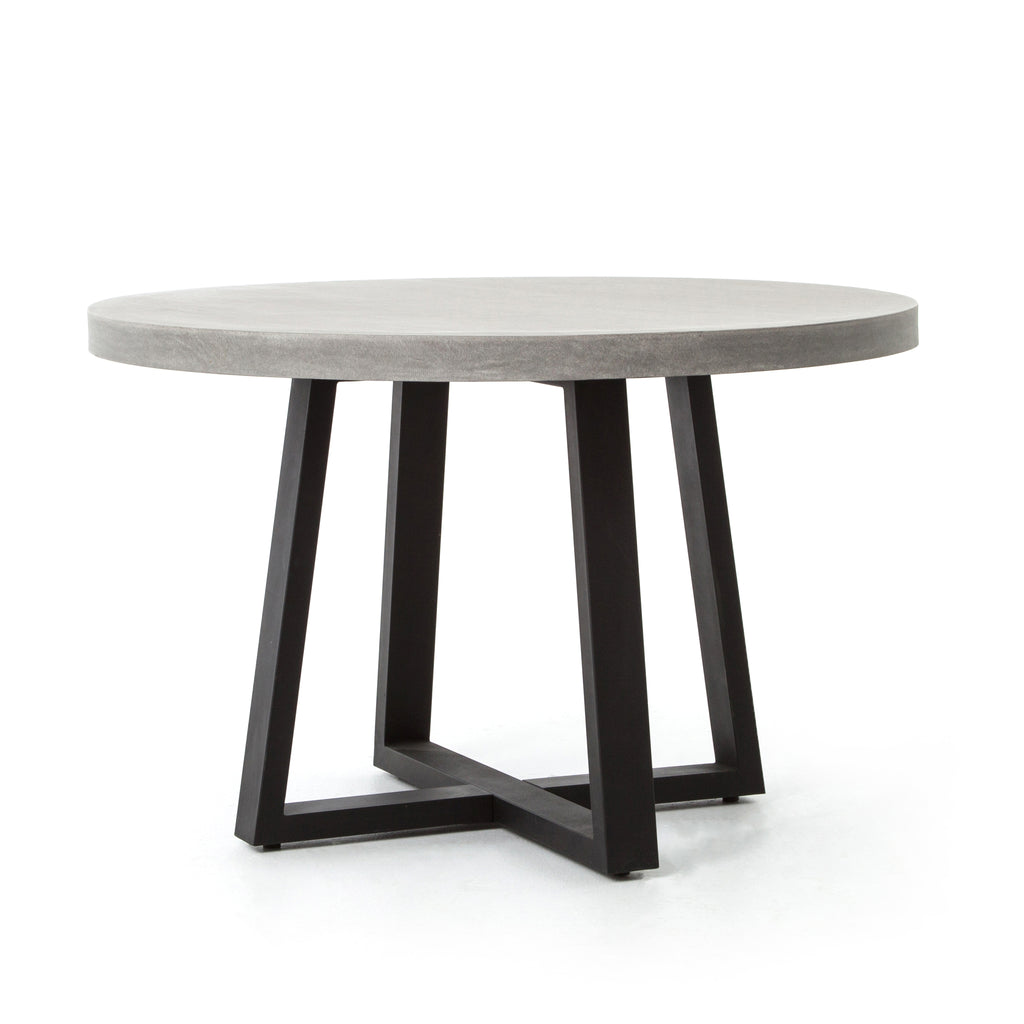 A strikingly simple, poly-resin top derived from river sand is polished to a smooth sheen. The angled, matte black iron base adds architectural appeal to this round dining table. Great indoors or out — cover or store indoors during inclement weather and when not in use.