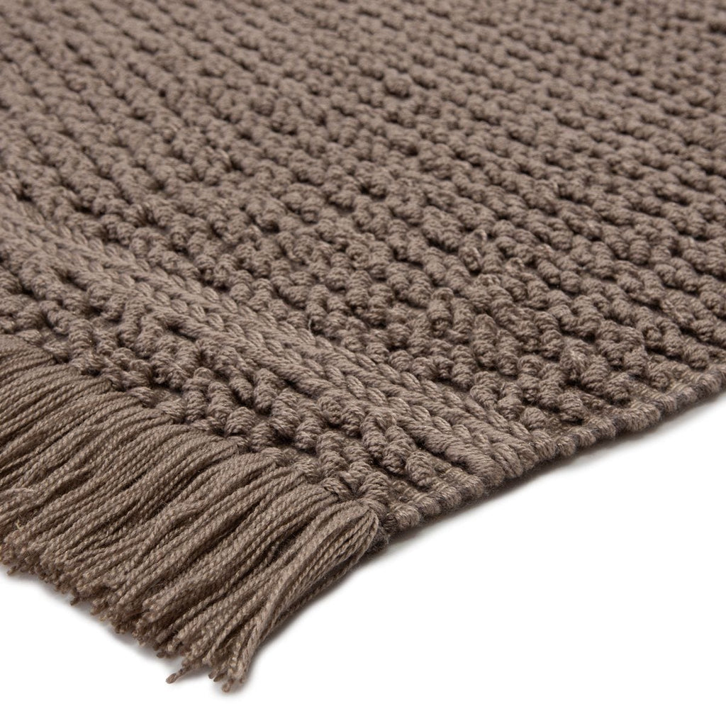Bohemian and rich with texture, the eco-friendly Villa Fallen Rock Area Rug, or VIL02, boasts a versatile handwoven design to both high-traffic areas and outdoor spaces. The Soleil area rug provides a relaxed, grounding accent to patios, kitchens, and dining rooms with durable PET yarn.