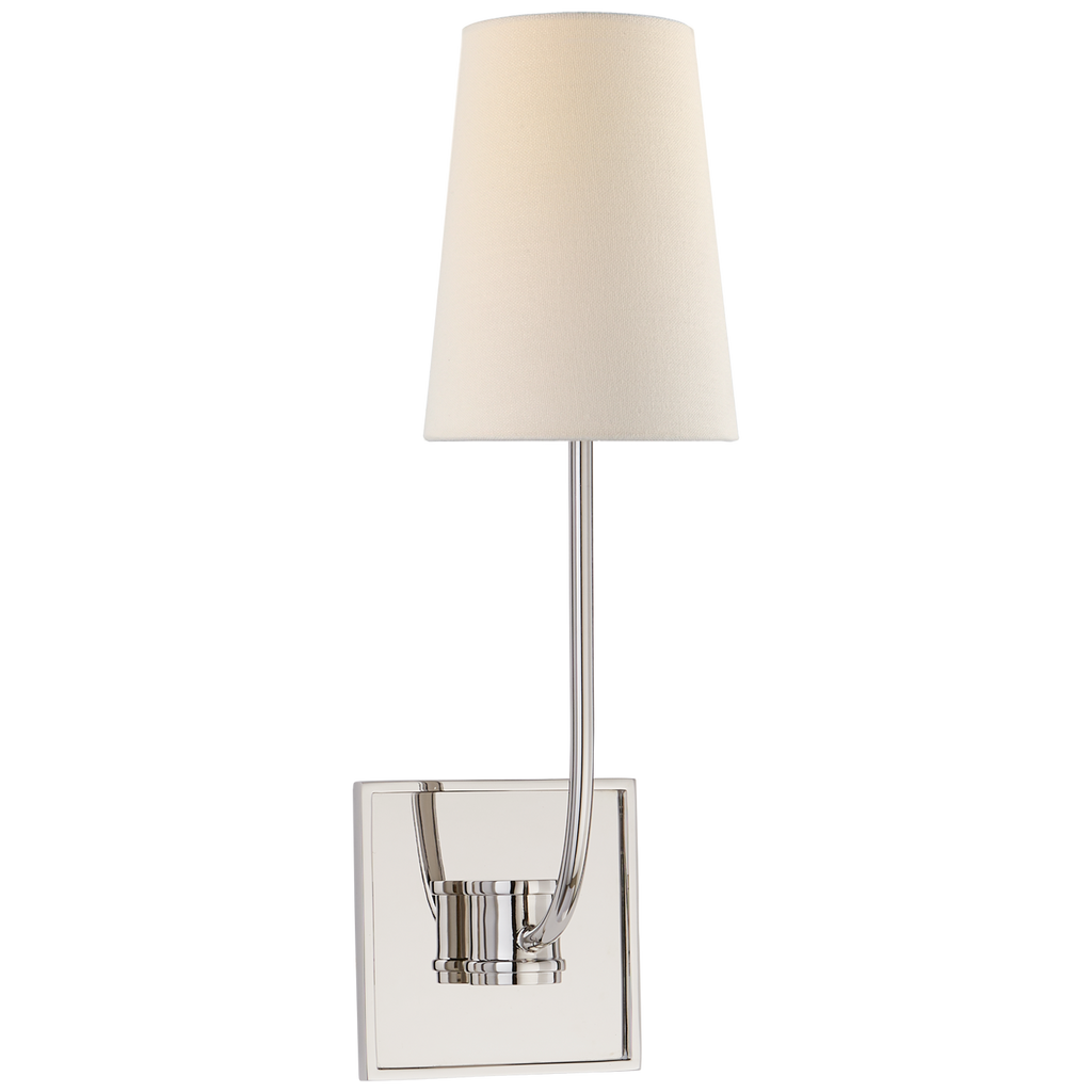 The Venini Single Sconce by Visual Comfort has a linen shade that exudes a warm glow. This is a timeless sconce to add in any bedroom, bathroom, or hallway   Designer: E. F. Chapman