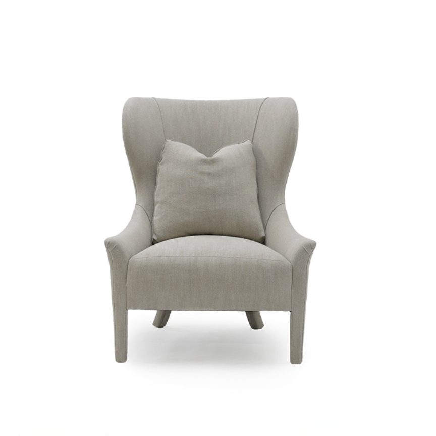 Instantly a timeless classic, our Ava Wing Chair has gorgeous curved arms with a tall, royal-like back. This comes standard with the following:  • Foam Down Wrap Seat Construction • Tight Seat Cushion • Notch Bottom Toss Pillow • Double Needle • Please Specify Leg Finish • Upholstered Only