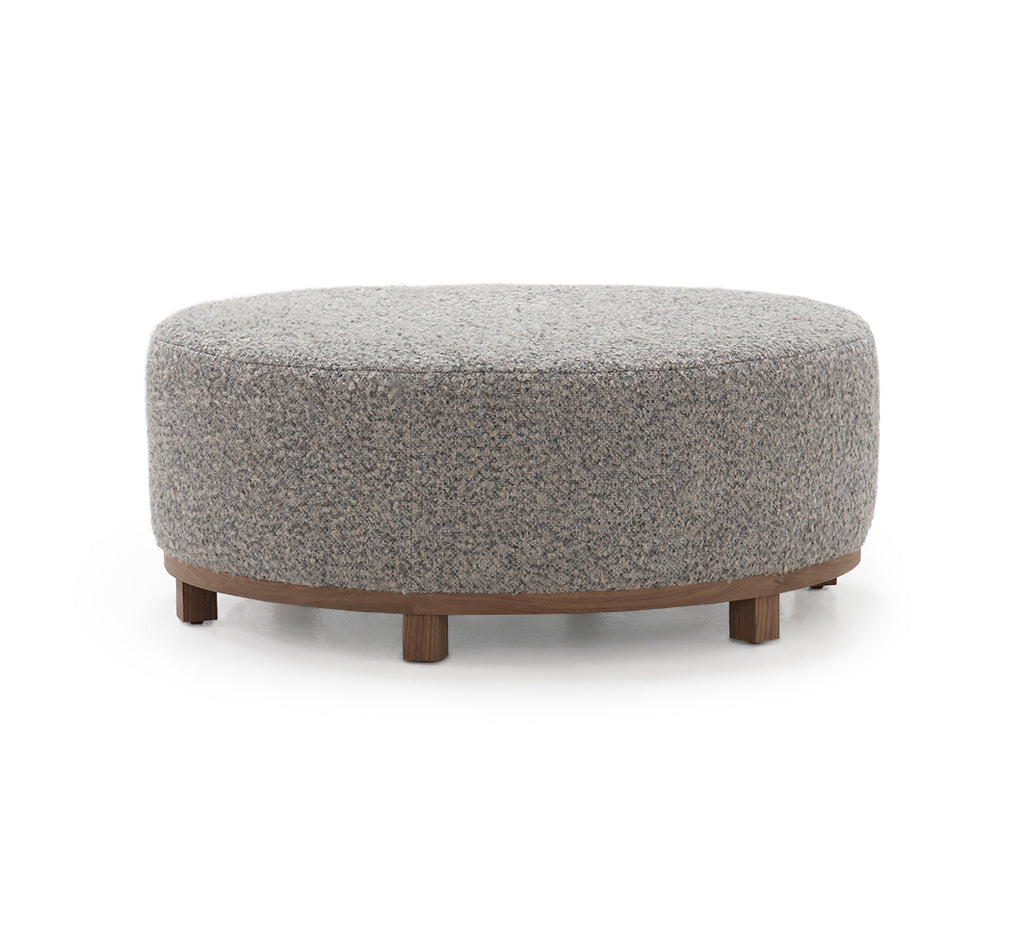 The Elliot Ottoman by Verellen is beautifully shaped and perfect for placing your favorite tray atop or relaxing on after a long day. This is bench-crafted with a sustainably harvested hardwood frame in Verellen's North Carolina atelier. It comes standard with:  • Foam and Fiber Seat Construction • Double Needle • Fabric Covered Ball Button on Top • Available Upholstered Base • Upholstered Only