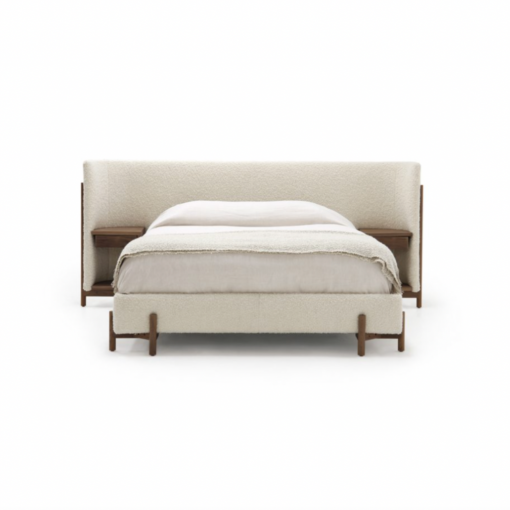 The Sullivan Bed by Verellen has built in side tables that take this bed to the next level. This functional and gorgeous bed features:  3″ inset mattress – accommodates mattress only built in side tables available upholstered only double needle stitch detail exposed wood legs Available with Table Finishes only. See page 3 of wood finish document.