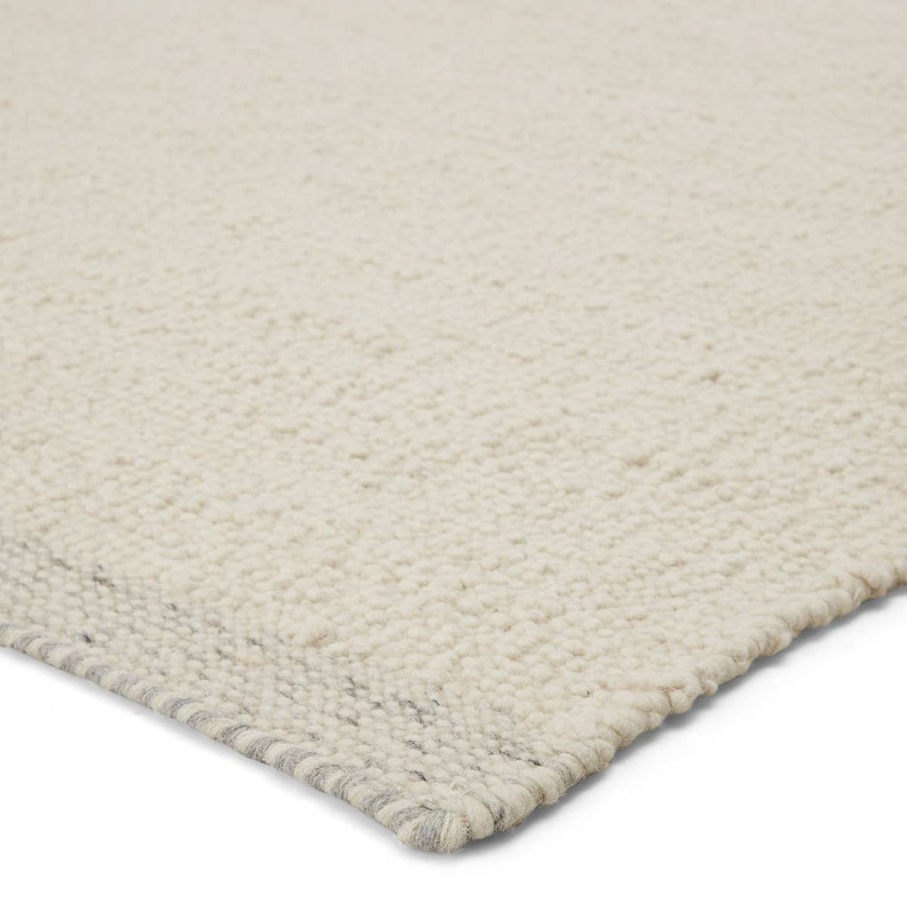 The Vestra Alondra Rug by Jaipur Living, or VST01, is hand-loomed and blended of durable wool and polyester. The light and bright Alondra rug features a textural, ivory design trimmed with flatwoven gray and ivory heathered edges. A perfect choice for your bedroom, living room, or other medium traffic area.
