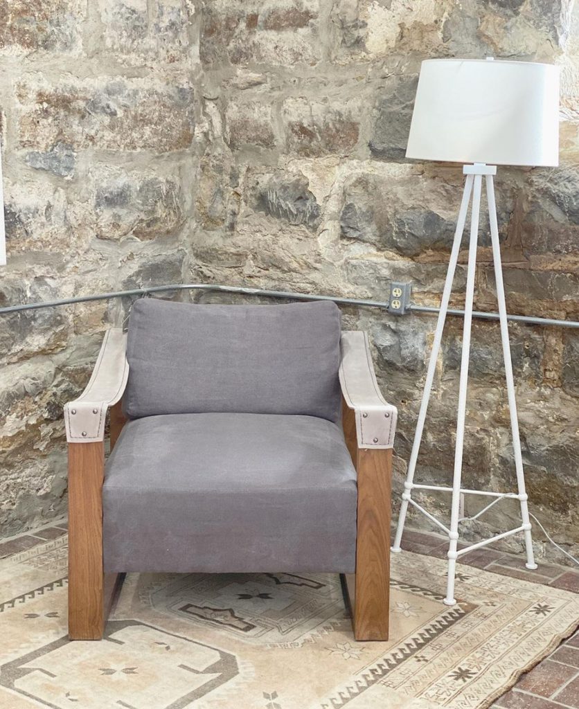 We love the thin, hammered tripod base of this Lafitte Large Floor Lamp by Visual Comfort. The linen shade brings a warm, modern look to any living room, bedroom, or other area needing extra light.