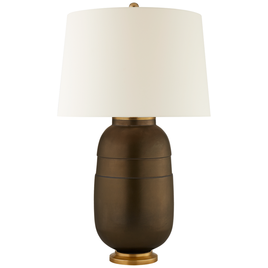 We love the ivory ceramic glaze and bronze combination on this Newcomb Medium Table Lamp. Paired with a natural percale shade, this piece will bring together any look. Use a pair of two in the bedroom, or let it shine on it's own bringing a warm ambiance to your workplace  Designer: Christopher Spitzmiller