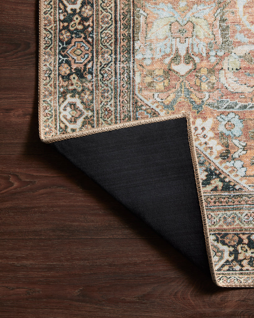 The Wynter Auburn / Multi area rug showcases a one-of-a-kind vintage or antique area rug look power-loomed of 100% polyester. This rug brings in tones of orange, brown, black, and hints of blue. The rug is ideal for high traffic areas such as living rooms, dining rooms, kitchens, hallways, and entryways.