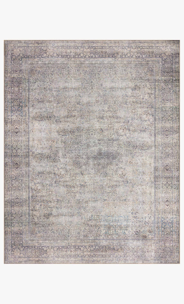The Wynter Silver / Charcoal area rug showcases a one-of-a-kind vintage or antique area rug look power-loomed of 100% polyester. This rug brings in tones of silver, gray, blue, tan, and hints of green. The rug is ideal for high traffic areas such as living rooms, dining rooms, kitchens, hallway, and entryways.
