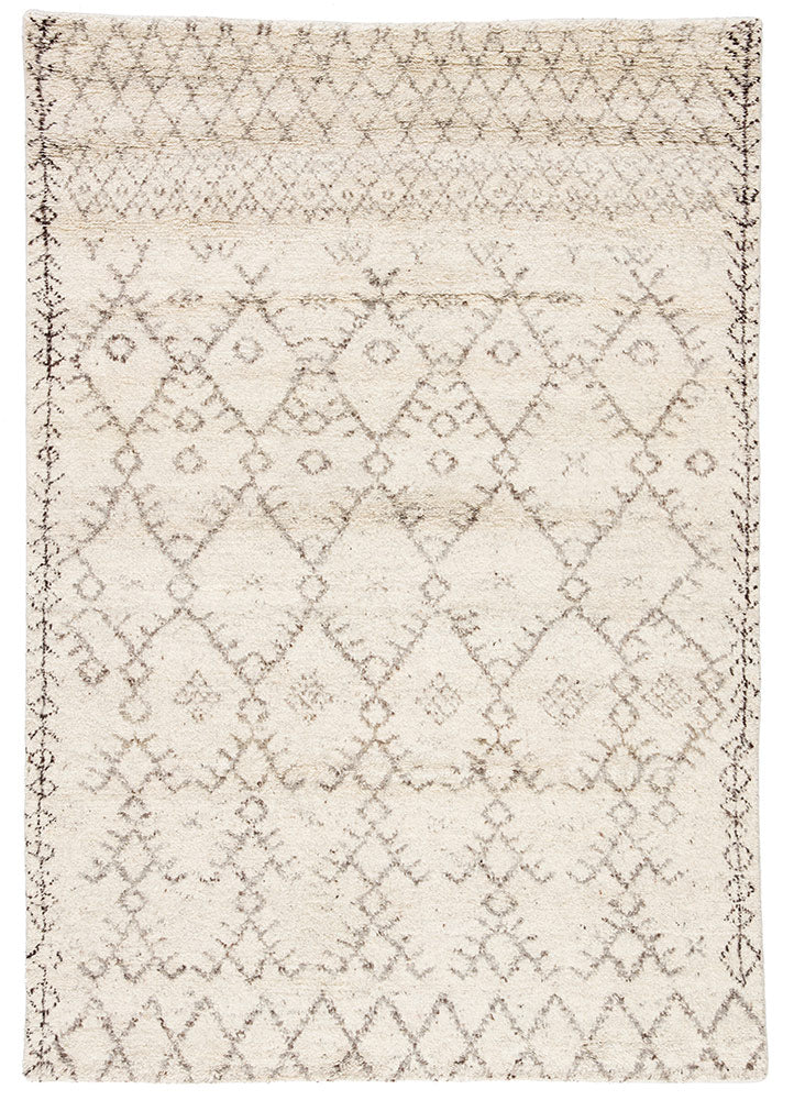 Soft and luxurious in feel, the Zuri Turtledove/Walnut area rug by Jaipur Living is a modern take on a classic Moroccan area rug. The Zuri is made from supple hand-knotted, 100% wool in natural tones of ivory and brown. This rug would be perfect for a living room, bedroom, or hallway in the runner size.