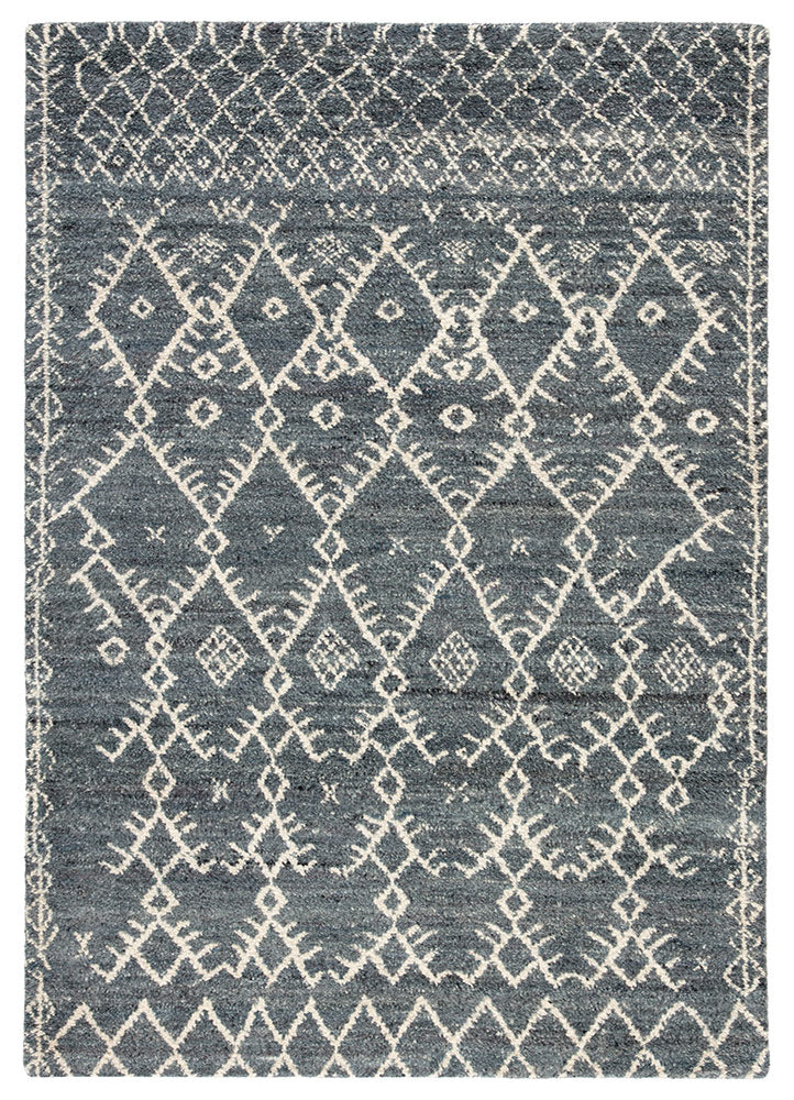 Modern Moroccan style defines the bohemian and authentic hand-knotted Zuri collection. The plush and luxurious hand-spun wool of the Zola area rug boasts a deep and inviting shade of blue. The globally inspired lattice design in ivory contrasts stylishly with the rich hue of the backdrop for a bold and free-spirited look in any space.