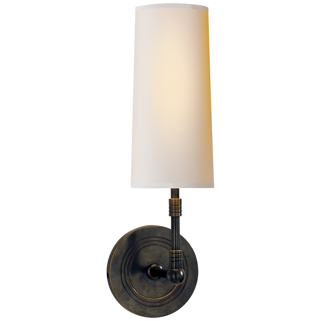 The tall, slim natural shade of this Ziyi Sconce sheds a soft, warm light. Place next to your bed or along the hallway to add some extra light to your home  Designer: Thomas O'Brien