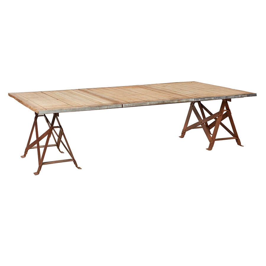 "Preserving naturally rustic imperfections, the Brickmaker XL Dining Table provides an unexpected statement to any dining room or patio collection. Laid with 3 reclaimed azobe wood pallets, each panel maintains its own unique character of intriguing watermarks and decorative scars. This trestle table has two waxed rust iron legs that contrast handsomely with its rudimentary table top. The Brickmaker Dining Table is an ageless and raw find  Size: 55.5"" w x 130"" l x 30"" h  Materials: Salvaged azobe wood, steel"