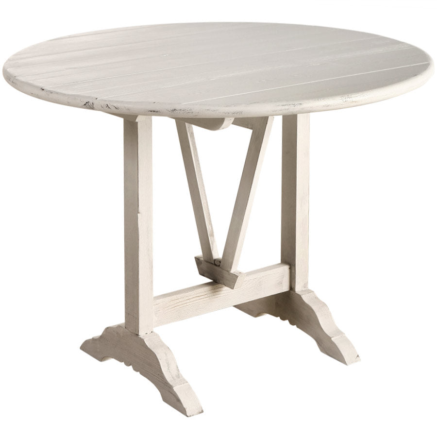 "The Bordeaux Occasional Table is a classic wine tasting table with a geometric trestle base. We love both the Whitewash and Elm finish and how it conveniently folds for storing.  Size: 39""d x 30"" h Materials: Solid Pine / Elm"