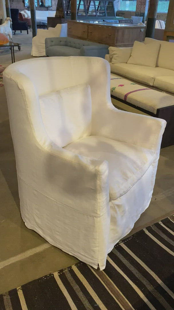 "The Havana Wing Chair by Cisco Brothers has a tall back with gorgeous curved arms. The go-to chair for guests or your favorite chair to read your latest novel in -- this will complete the look for any living room or lounge area. Shown in slipcover Otis White and Bellamy Oatmeal.   Overall Dimensions: 32""w x 40""h x 32""d Seat Height: 18"" Seat Space: 22""w x 17""d"