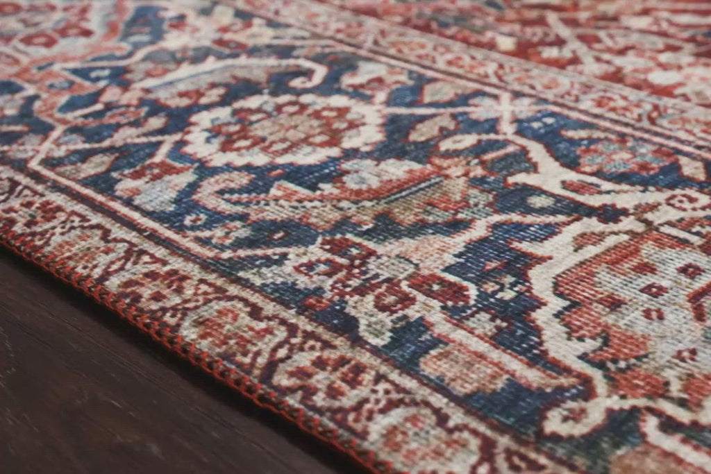 The Layla rug collection from Loloi is traditional and timeless, with a beautiful lived-in design that captures the spirit of an old-world rug. This traditional power-loomed rug is crafted of 100% polyester with a classic and sophisticated color palette and subtle patina.  Power Loomed 100% Polyester LAY-08 Red/Navy Colors: Red, Navy, Blue, Ivory
