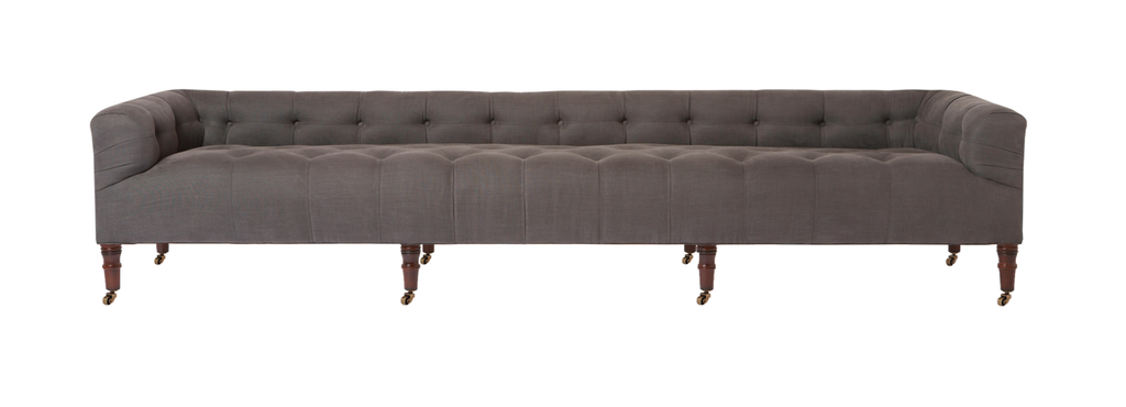 "A glorious, nine foot tufted sofa on casters with leaps of old world meets modern style!  A design collaboration between Cisco Brothers x John Derian.  As shown in JD Vintage Steel 100% Linen.  108""w x 27""d x 22"" high  Seat space: 94""w x 20"" deep  Seat Height: 16"""