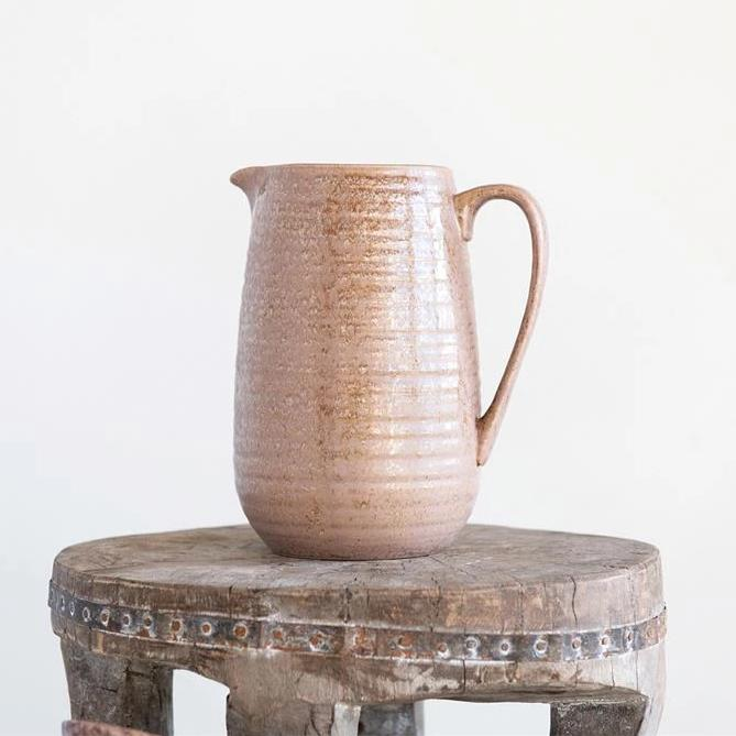 Beautifully unique, ceramic reactive glaze pitcher with pink undertones.