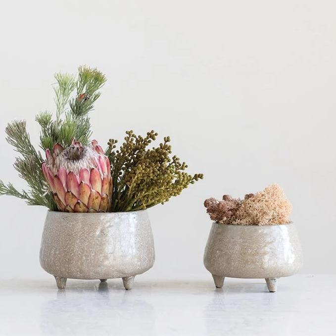 "This adorable beige planter is a fun way to hold potted plants! The planter can hold up to a 3"" potted vessel. Each planter is hand-crafted and glazed which will slightly differ in appearance."