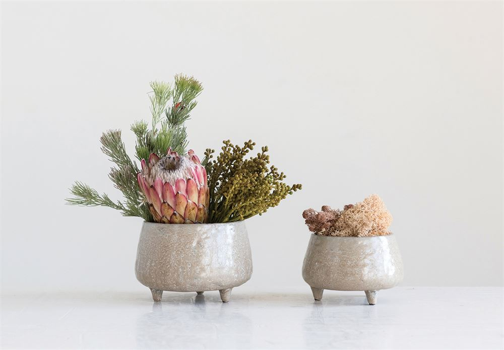 "This adorable beige planter is a fun way to hold potted plants! The planter can hold up to a 4"" potted vessel. Each planter is hand-crafted and glazed which will slightly differ in appearance."