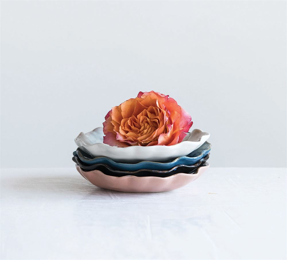 These gorgeously scalloped, hand formed, porcelain plates are beautiful displays. Each plate is glazed and are all unique in an assortment of color. A plate could be used to hold flowers or pebbles to decorate a table, mantle, or shelf!