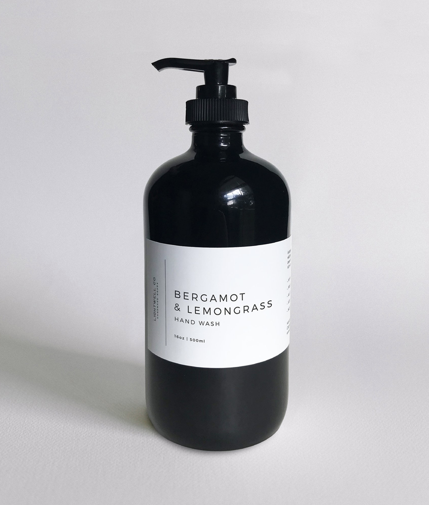 This gorgeous hand wash is a blend of vibrant lemongrass and citrus with bergamot for an uplifting and invigorating aroma. A single pump of lathering hand wash will gently cleanse your hands without over-drying and stripping them of their natural oils. It comes in a black glass Boston round bottle wrapped with a waterproof minimalist label. Please check out our FAQ for a full list of ingredients.  Fragrance notes: lemongrass, citrus, sage, and white musk