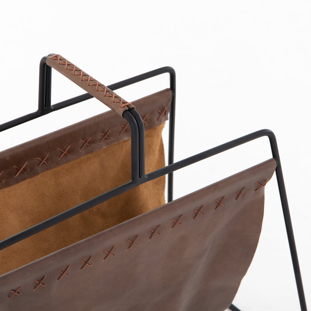 "We love the cross-stitching details on this patina brown, top grain leather Aesop Magazing Rack. A gorgeous piece to place all your favorite magazines or important papers in, while also bringing a stylish mid-century vibe to your office or other space.  Overall Dimensions: 18.50""w x 11.75""d x 19.00""h Materials: Top Grain Leather, Iron Colors: Patina Brown, Smooth Jet Black"