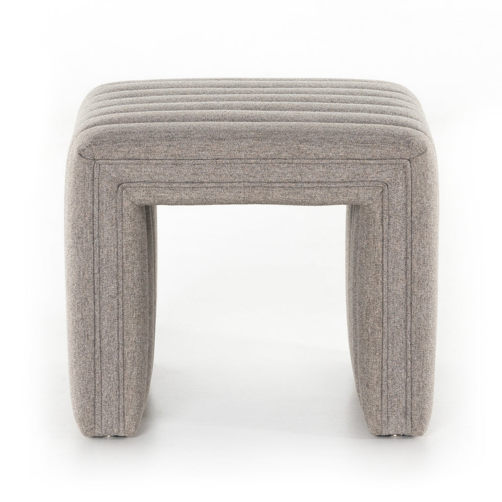 "We love the dramatic channeling of this Augustine Ottoman - Orly Natural. Match it with the Augustine Swivel and complete the whole space!  Overall Dimensions: 21.50""w x 21.00""d x 18.00""h  Colors: Orly Natural Materials: 100% Polyester"
