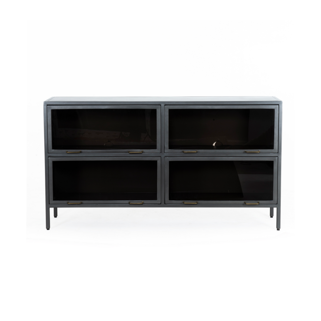"Inspired by the stackable barrister-style shelving, the Aviva Barrister Sideboard has iron casing finished in a gunmetal for a fresh industrial look, with smoked glass panes with brass hardware cover door fronts, each lifting to spacious compartments for storage of media, tableware and more.  Overall Dimensions: 65""w x 15""d x 36.5""h Colors: Smoked Glass, Flat Brass, Gunmetal Materials: Glass, Iron"
