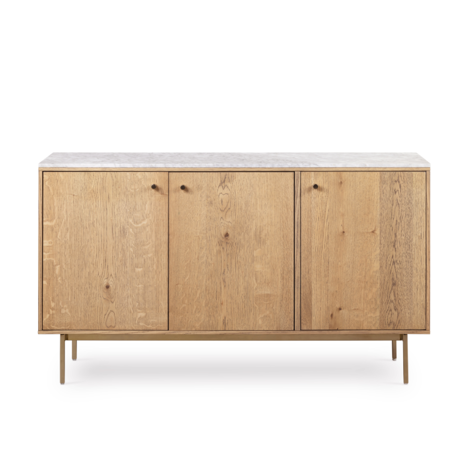 "The Montrose 3 Door Sideboard is a fresh material mixed with dote modern airs. A dry oak sideboard with brushed brass legs and hardware is topped by a smooth top of white marble, nodding sophisticated Victorian-era styling. Pieces may vary slightly, reflecting the natural variation in marble shade and veining.  Size: 54.00""w x 18.00""d x 31.00""h  Colors: Slim Dry Oak, Brushed Brass, White Marble Materials: Oak Veneer, Iron, Solid Marble"