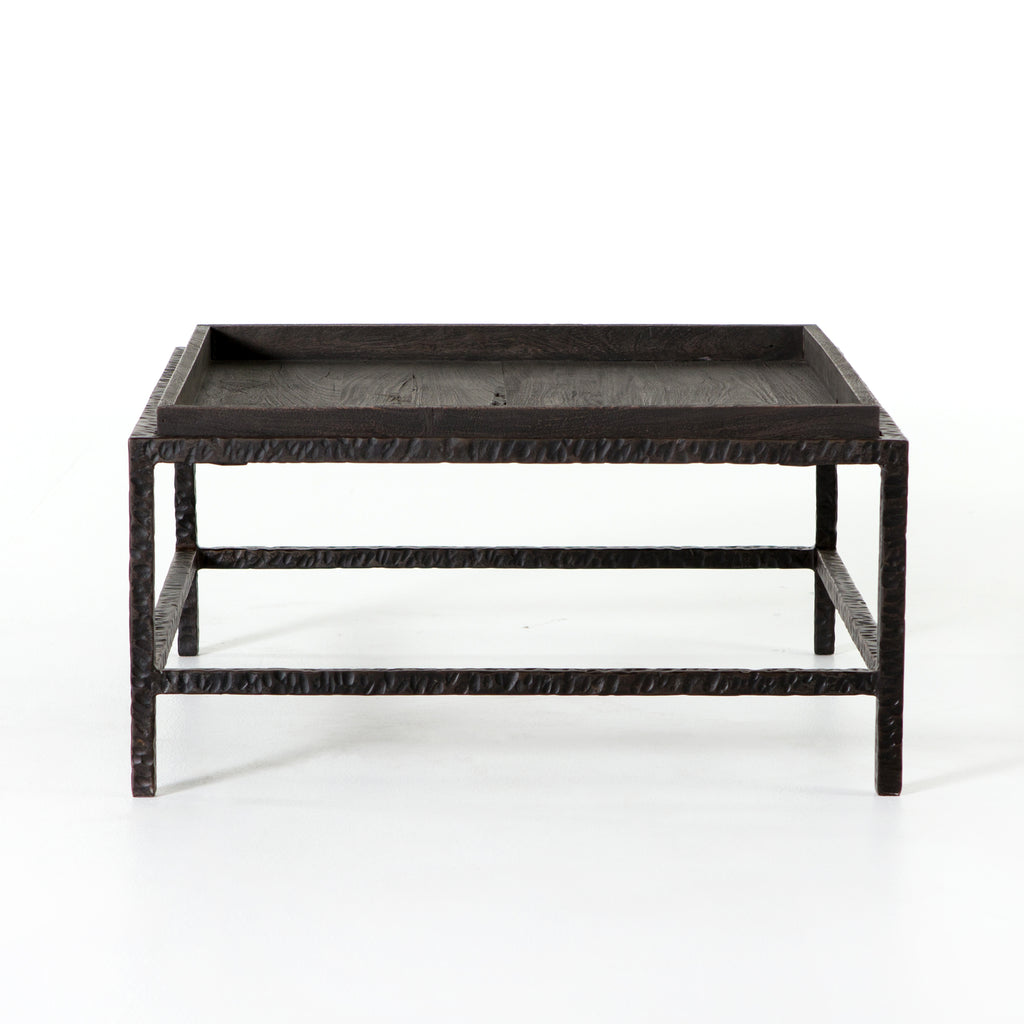 "The Pierson Bunching Table has layers of intrigue. Slim, hammered iron legs support a square-shaped tabletop for a rich yet rough-hewn look that reveals itself more around every angle. Grey mango wood is sandblasted to further an organic, primitive vibe with a modern stance.  Size: 30.00""w x 30.00""d x 15.00""h  Colors: Rustic Ridge, Elephant Grey Materials: Iron, Mango Wood"
