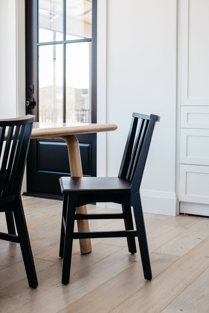 The Primm Matte Black Dining Chair has a matte black finish that lends sleekness to this updated take on the traditional Windsor. Crafted from mixed reclaimed woods, this add a raw, organic feel to any dining room or seating area.   Amethyst Home celebrates natural materials, which often come with beautiful imperfections. Each piece is made uniquely for you! Please expect some variation and character -- we embrace the design approach of Wabi Sabi.